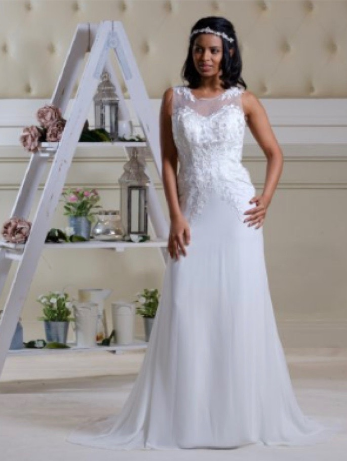 Applique lace bodice on a white wedding dress with chapel train, front view