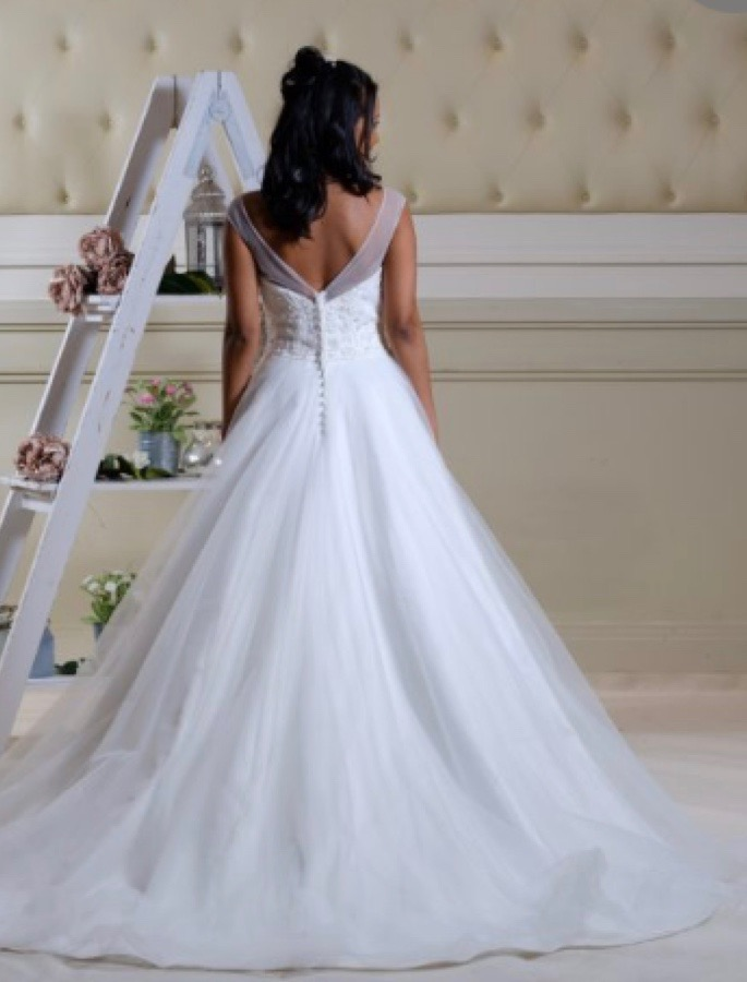 Full skirted wedding gown with a sweetheart neckline, back view