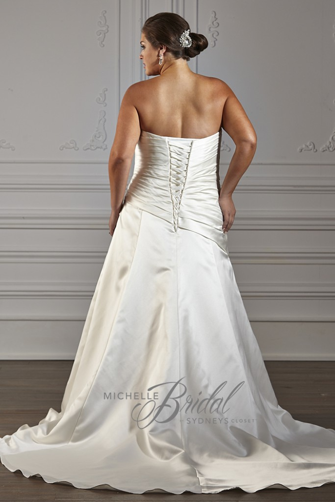 Plus size strapless satin gown with sweetheart neckline featuring a corset lace-up back, front view