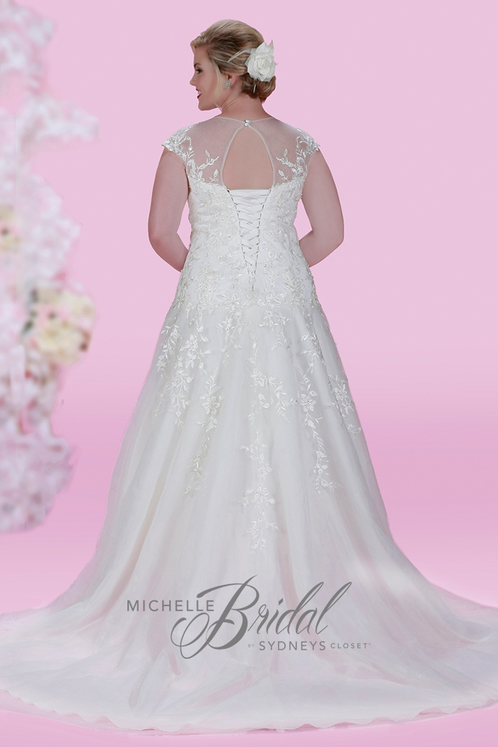 Plus size embroidered lace wedding dress with sweetheart neckline, illusion bodice, a corset lace-up back and chapel train, front view