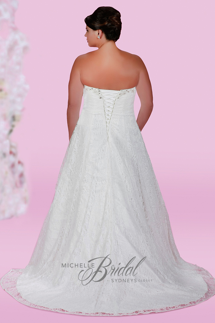 Plus size strapless lace wedding dress with sweetheart neckline featuring a corset lace-up back and chapel train, back view
