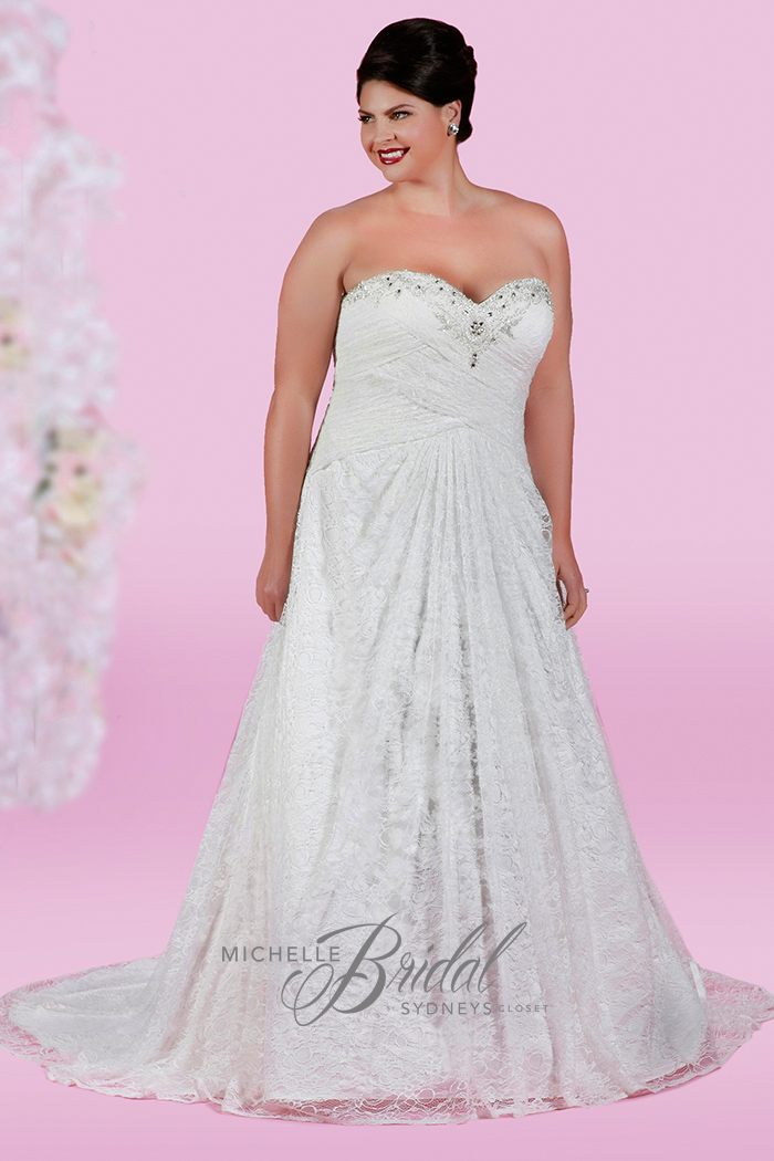 Plus size strapless lace wedding dress with sweetheart neckline featuring a corset lace-up back and chapel train, front view