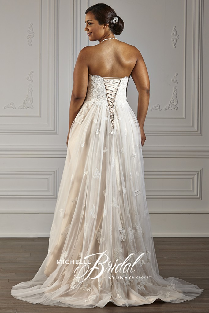 Plus size strapless net and lace gown with a lace-up corset, back view