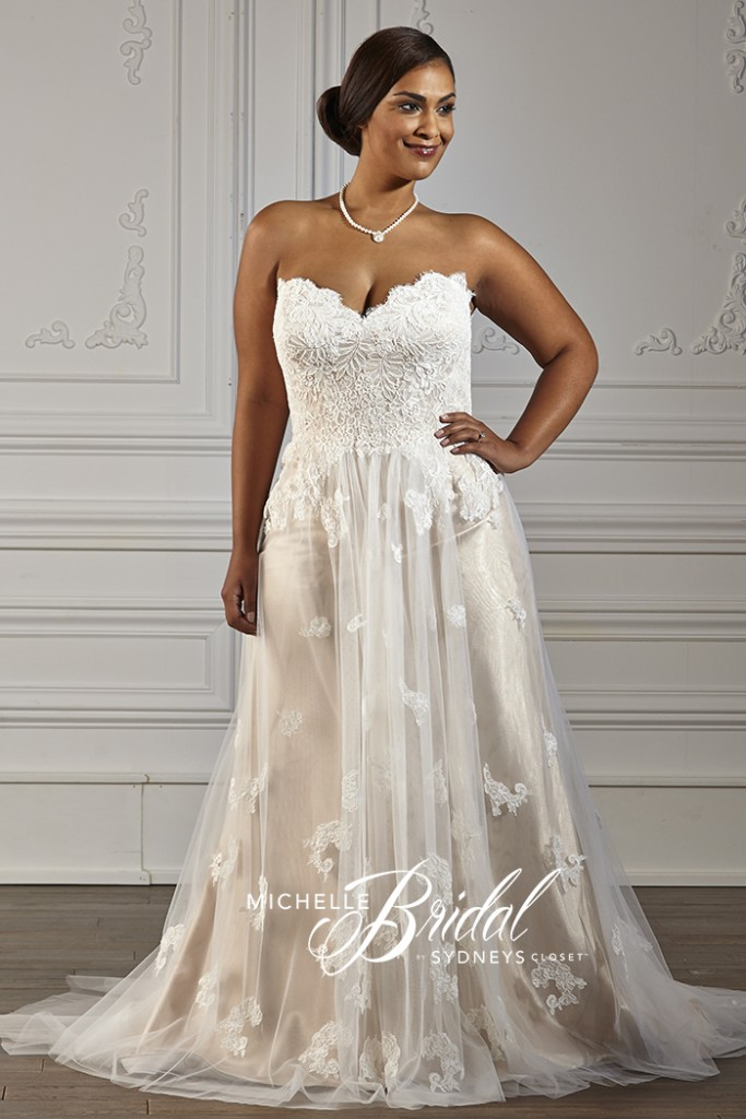 Plus size strapless net and lace gown with a lace-up corset, front view