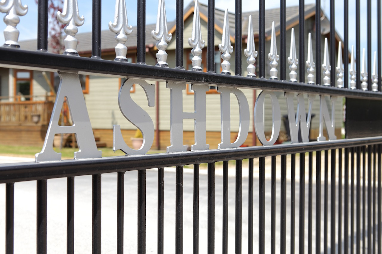 Image of the wrought iron gates with Ashdown written on them