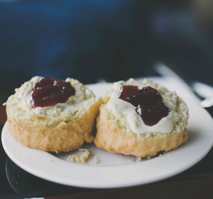 Home baked scones with jam and cream