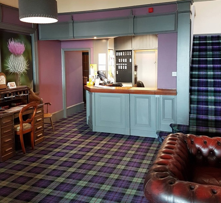 Our welcoming Reception area painted in duck egg blue has a beautiful green and purple tartan carpet