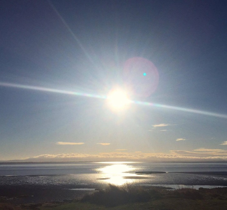 The sun going down over the Solway Firth with views to Cumbria