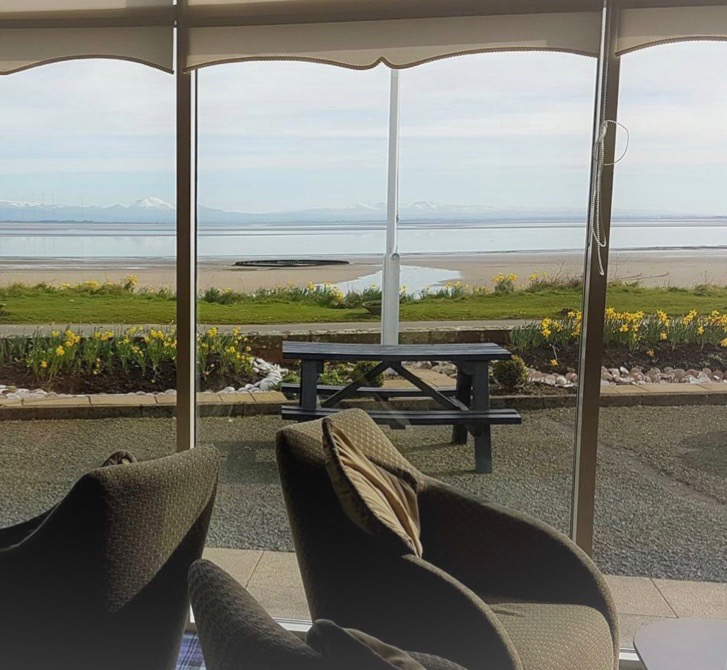An uninterrupted view from the Powfoot Hotel lounge over the beach and the Solway Firth to Cumbria beyond