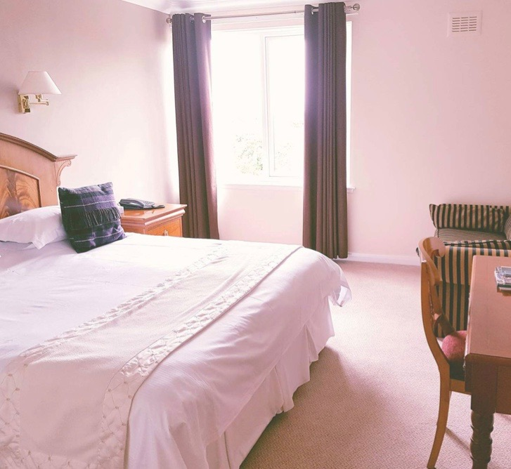 One of the double bedrooms with crisp white bedlinen