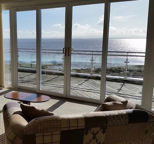 The Powfoot loung has large French windows that open out onto a decking area overlooking the beach and the Solway Firth.