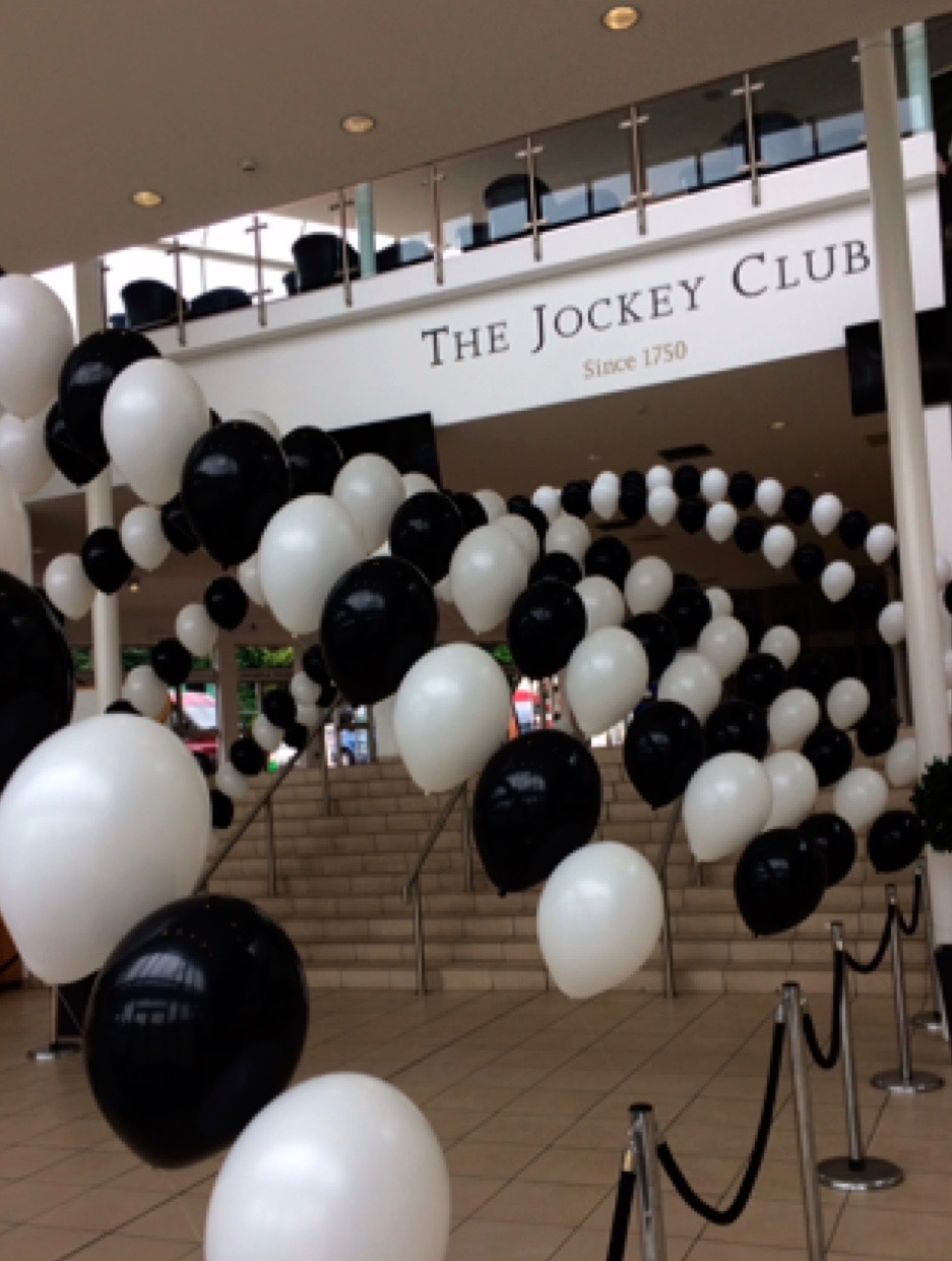 Black and white balloon arch displays at The Jockey Club