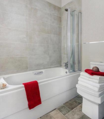 Comfy Full Length Bath Over Shower And Sliding Door By Regal Park Homes