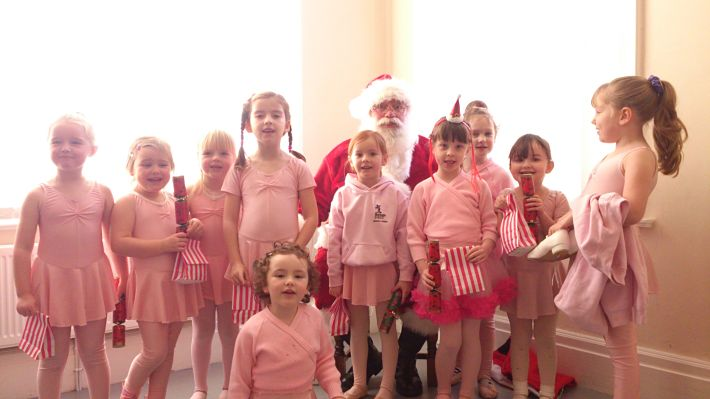 Children getting a visit from Santa at dance class!!