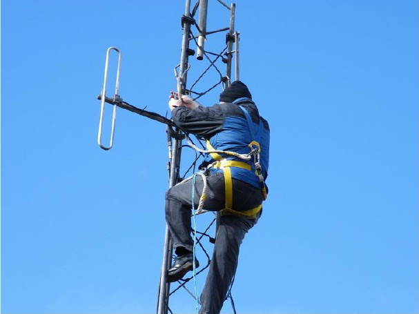 Climbing the tower at the Cambret Hill repeater station in Dumfries and Galloway
