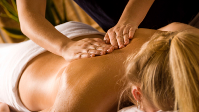 Spalding Osteopath Treating Female Back Shoulder Pain