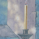 A candle against a wall