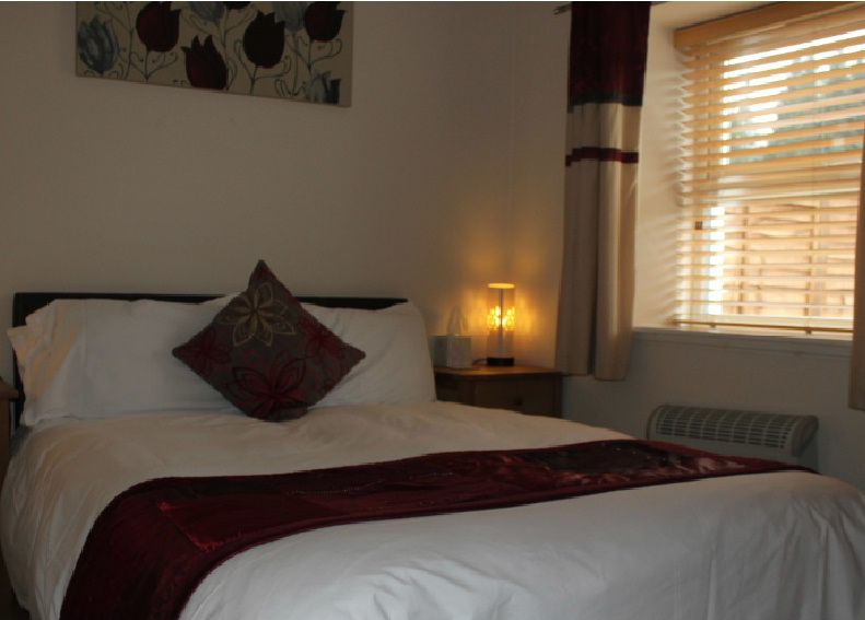 The double bedroom within Curlywee Cottage, Bargrennan