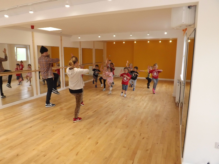 The exercise and dance studio at Dalbeattie's Bridge Wellness Centre showing a class with young children dancing