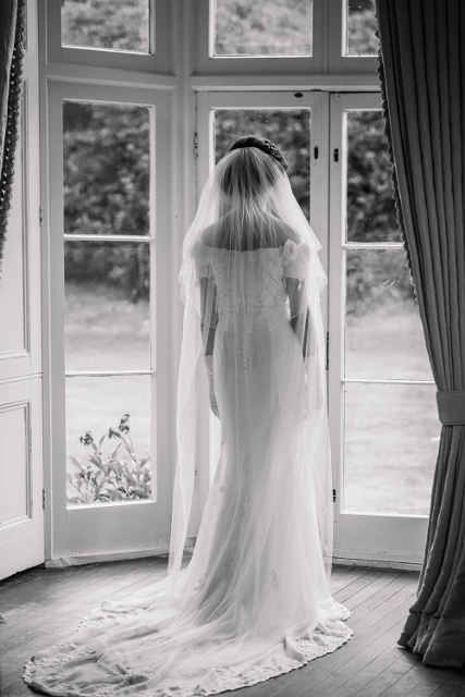Sophie is a long wedding gown with a beautiful train.