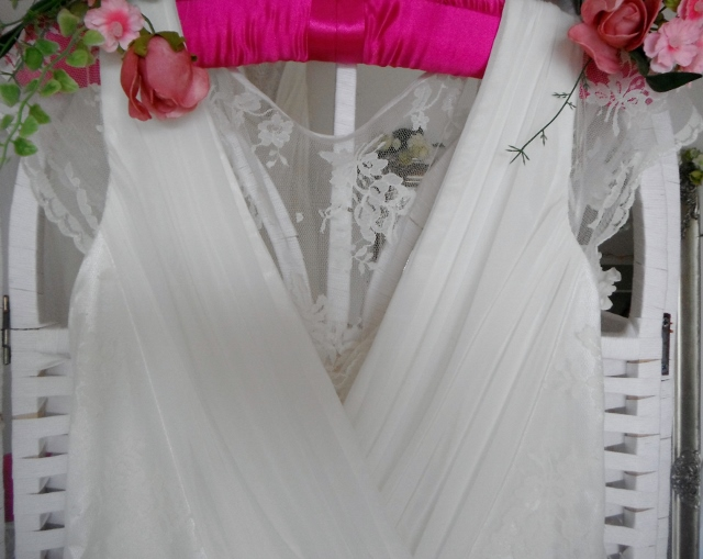 We stock wedding dresses with a vintage feel. This wedding dress is made of chiffon and lace