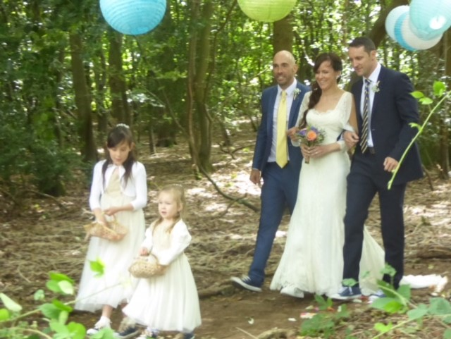 A woodland glade wedding featuring a vintage style wedding dress