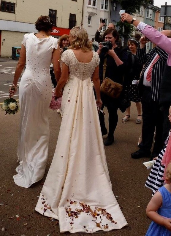 The bride wore a vintage, Jane Austen style wedding dress with an empire line.