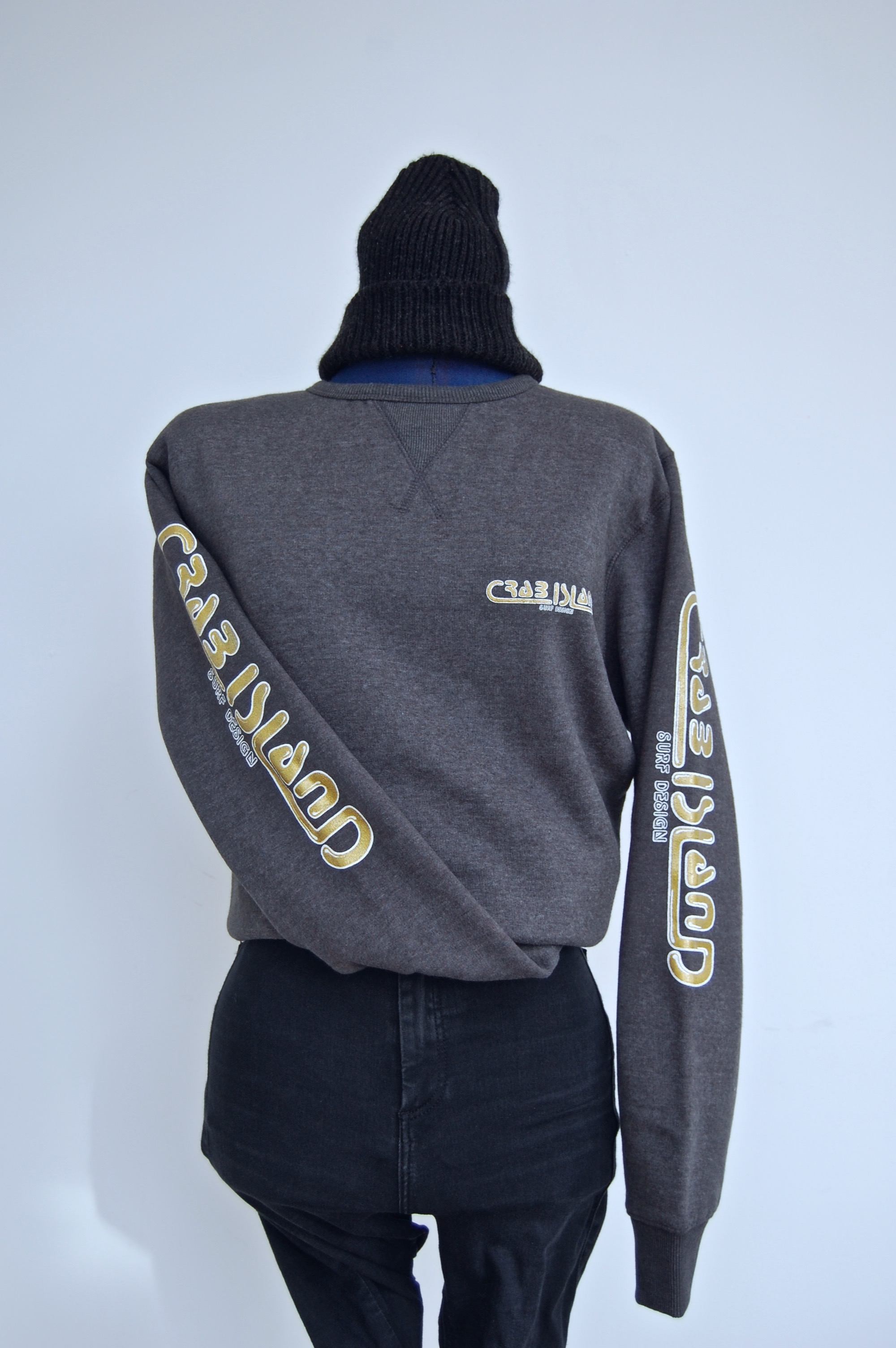 Dark grey jumper with Crab Island Surf Design logo