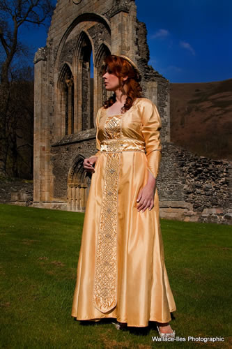 Gold empire line medieval gown with beadwork and celtic knotwork
