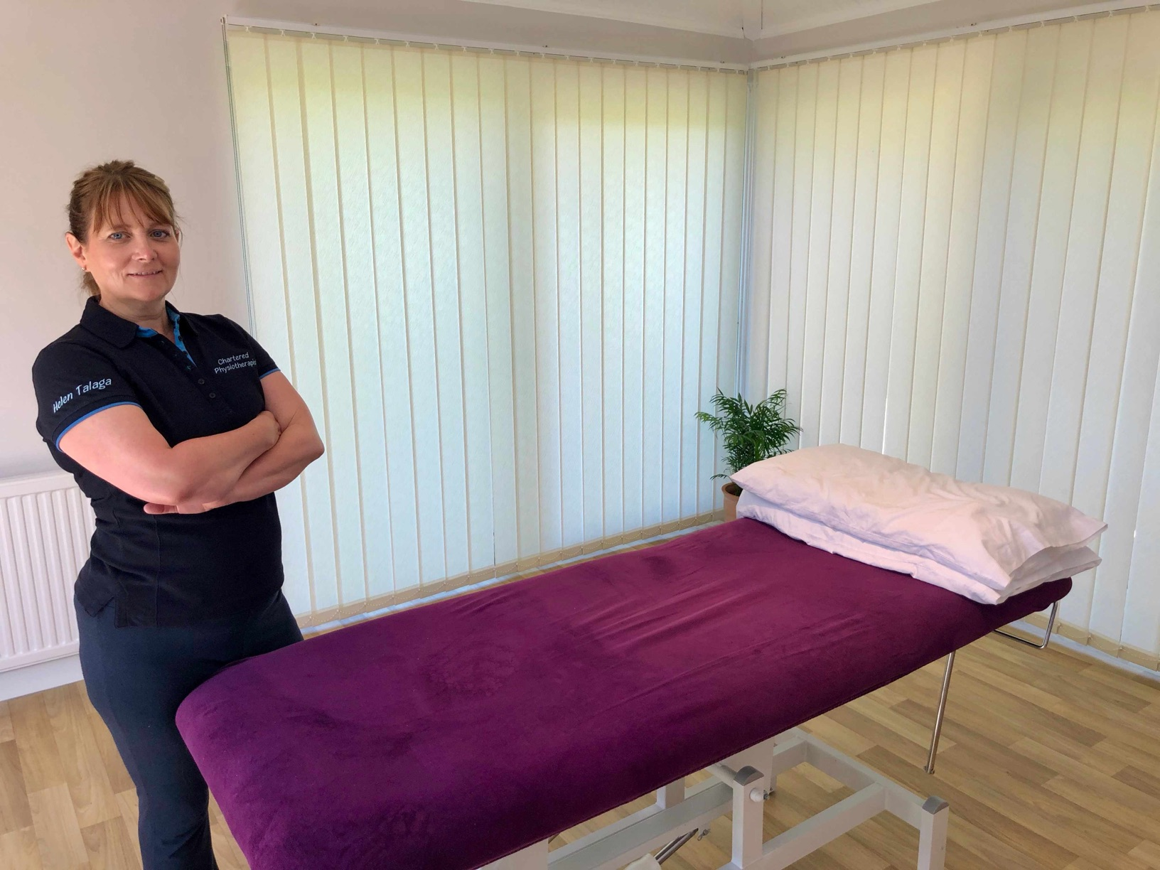Helen Talaga standing next to a treatment bed