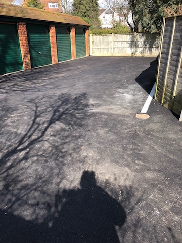 New tarmac surfacing at lock up garages in West London laid by West London Paving