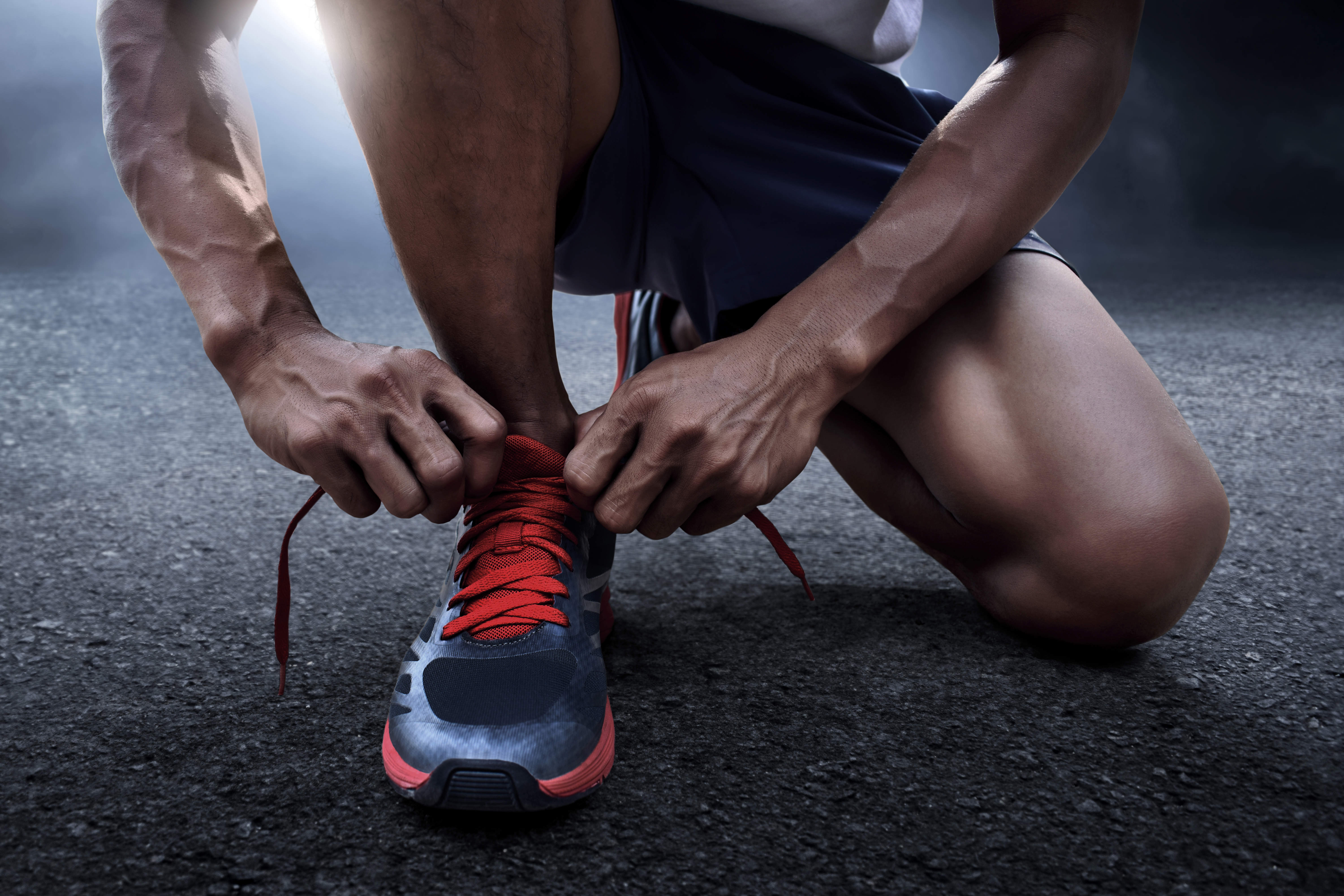 Runner tying his laces