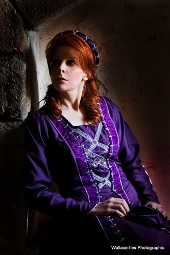 Purple matt medieval gown with velvet trimmings and silver beadwork