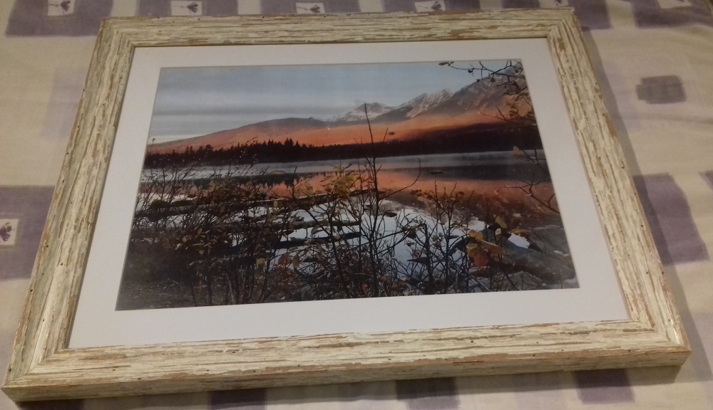 Photograph of Canada in a rustic frame.