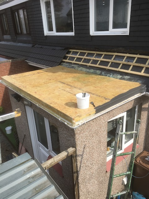 Beginning the process of repairing a flat roof extension with long lasting finish