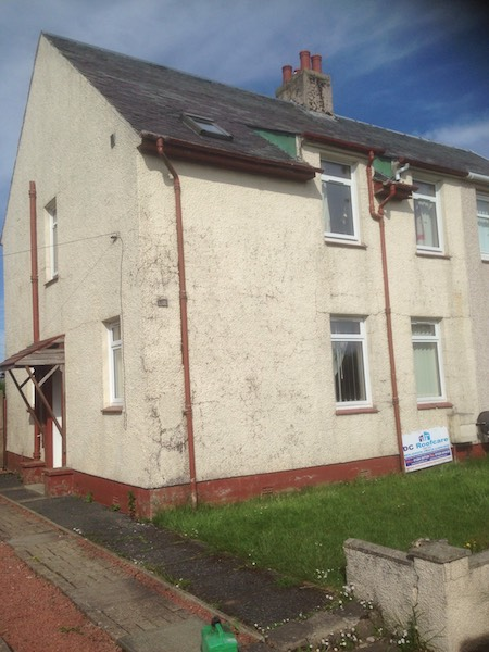 Before image of an ex-local authority house in Mauchline, Ayrshire, with dirty, marked external walls, rone pipes and guttering