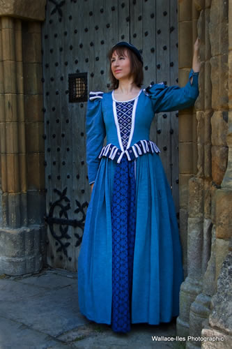 blue medieval gown. contrast in heavy brocade with white pipping