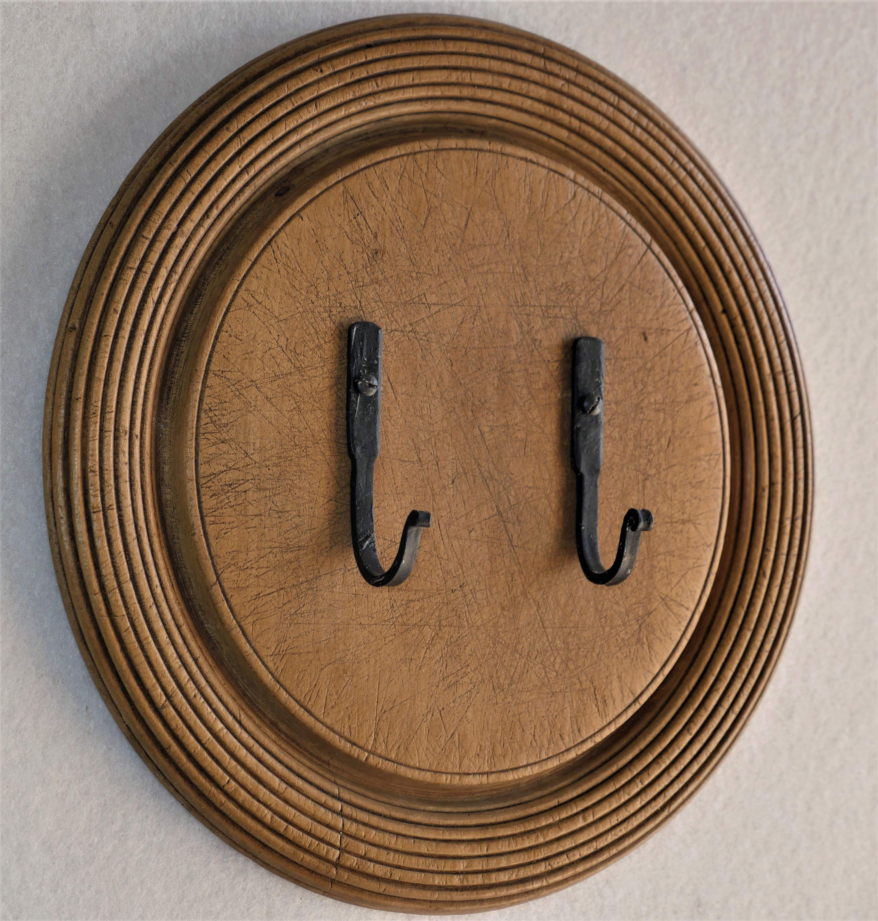 Vintage concentric design breadboard with hand forged hooks on.