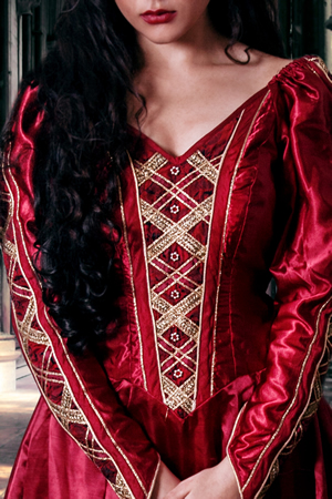 Red medieval gown with criss cross ribbon on the front and beading