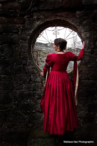 red medieval gown with lighter front panel. Embroidered and beaded