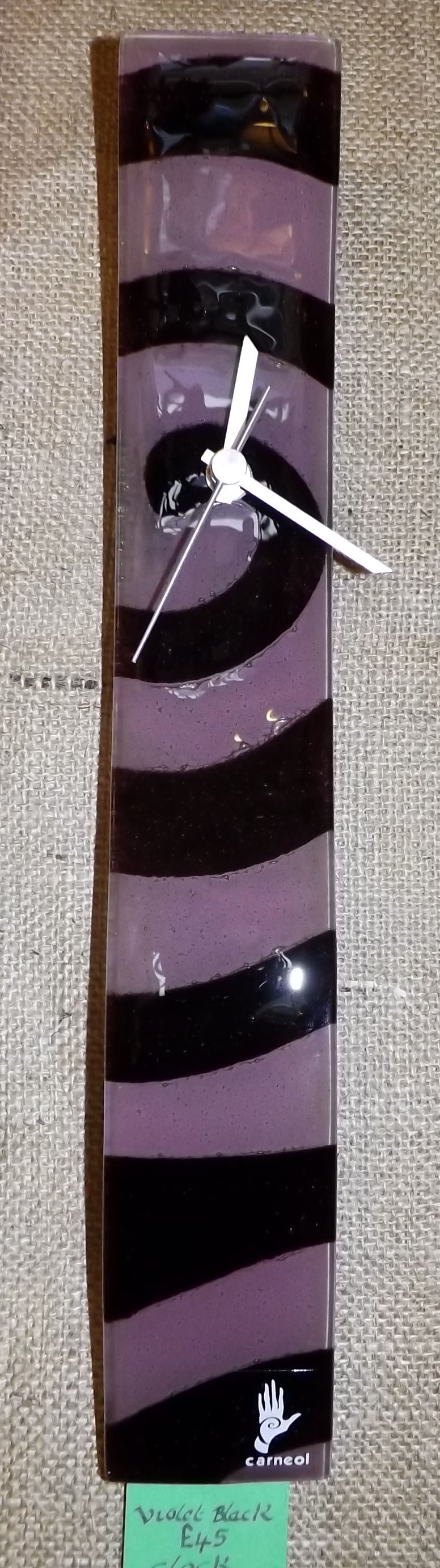 Glass wall clock black and violet colours.