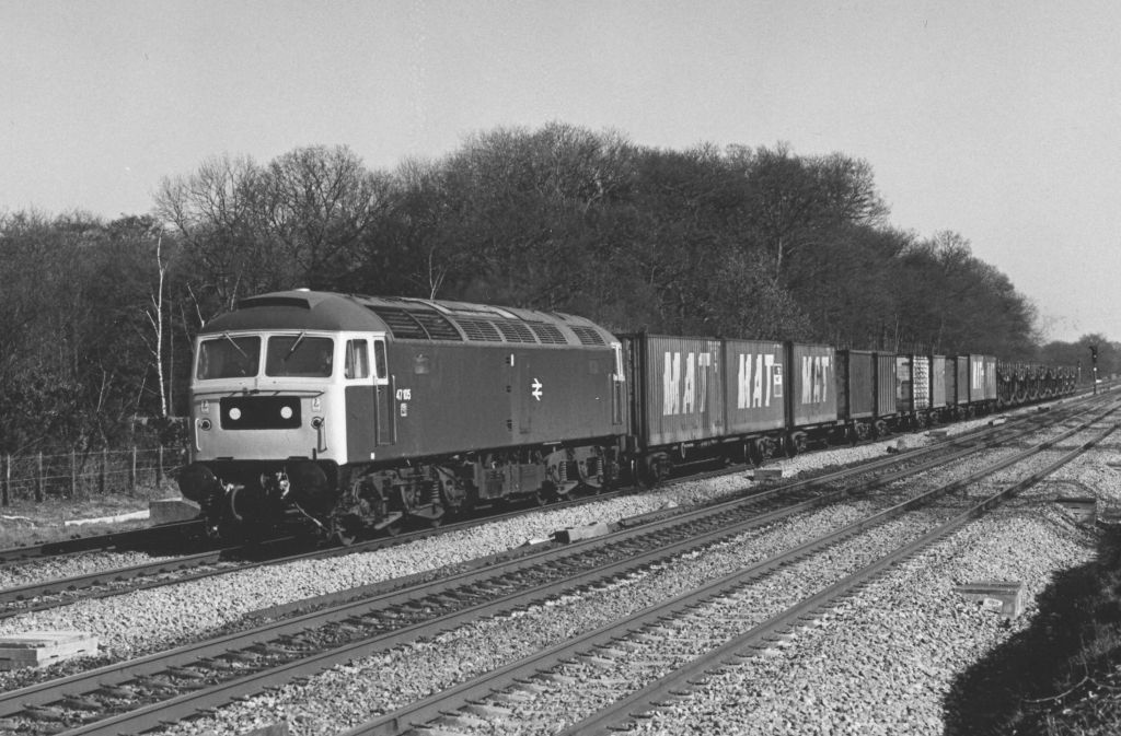 47105 passing Twyford West working a Ripple Lane-Southampton Freightliner on 4/3/80 (C Marsden)