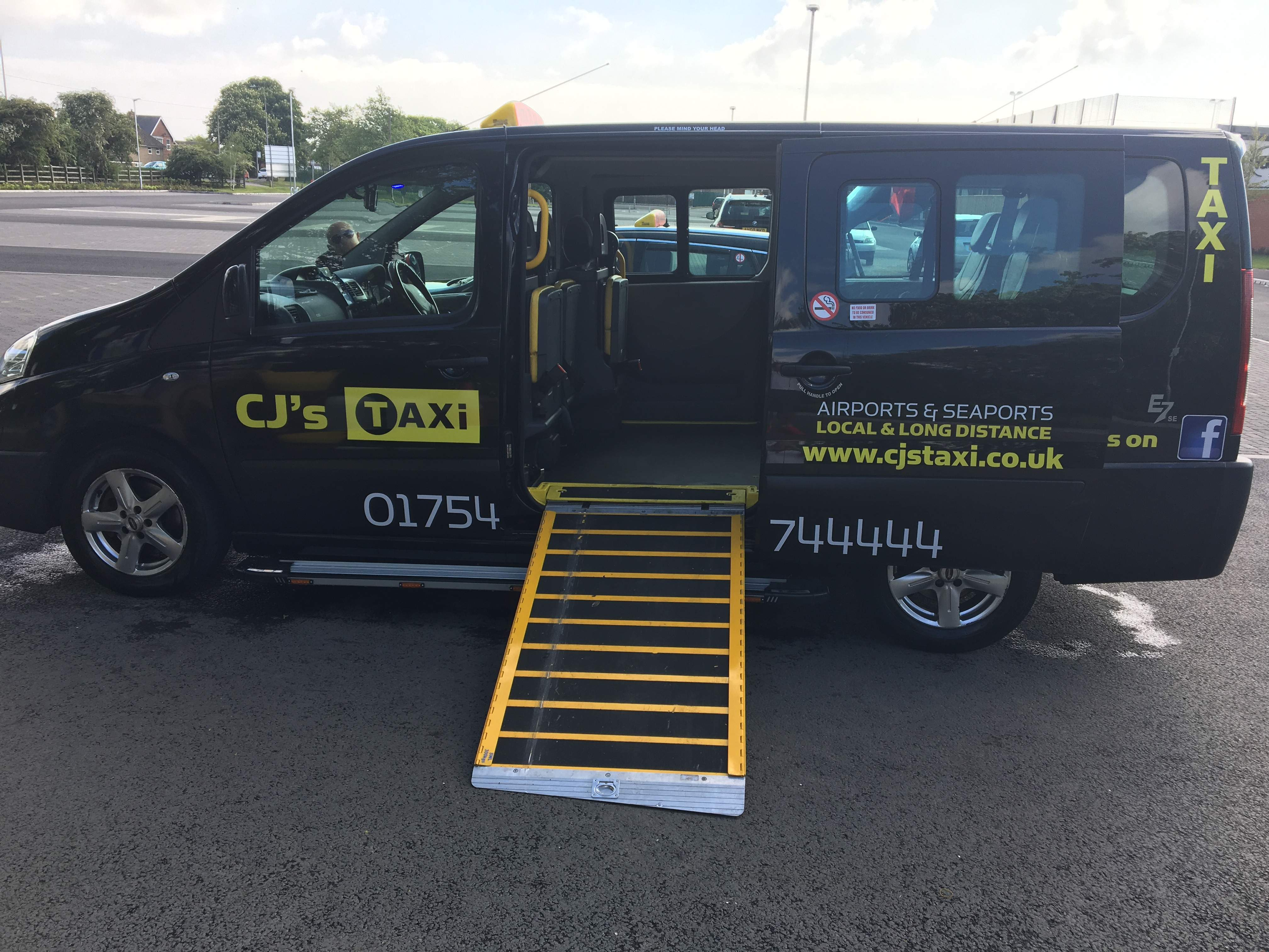 wheelchair accessible taxi with side loading ramp