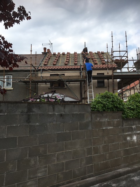 Fitting new roof tiles