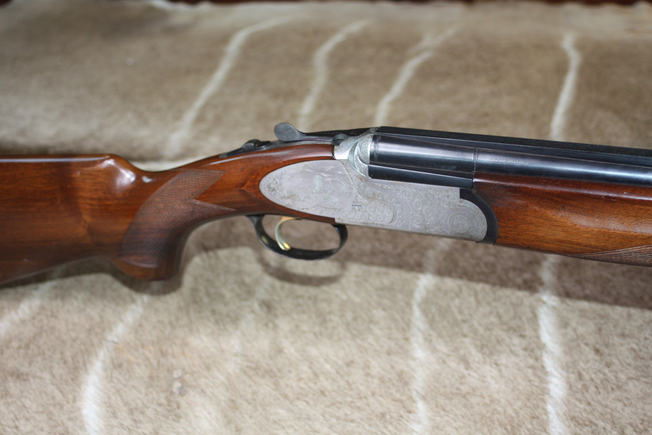 RIZZINI 12-BORE SINGLE-TRIGGER SIDEPLATED OVER AND UNDER  EJECTOR