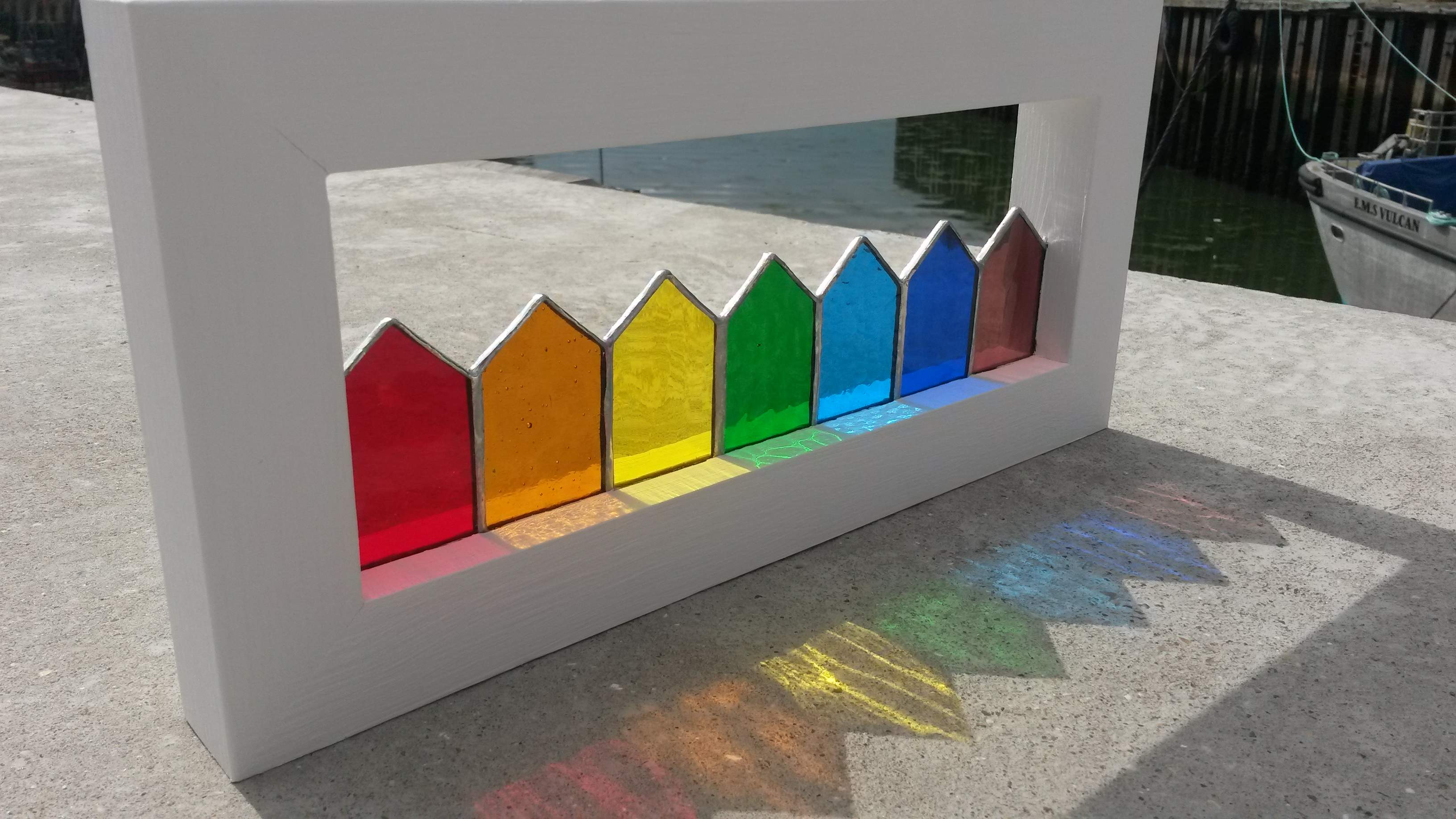 Rainbow beach huts in bespoke wooden frame