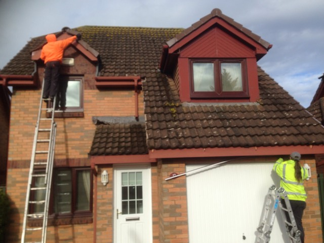 DC Roof Care team at work removing old ridge tiles and fascias from a two-storey house in Prestwick, Ayrshire