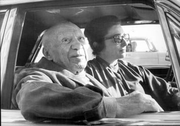 Pablo Picasso and Jacqueline in a car at Cannes in 1970