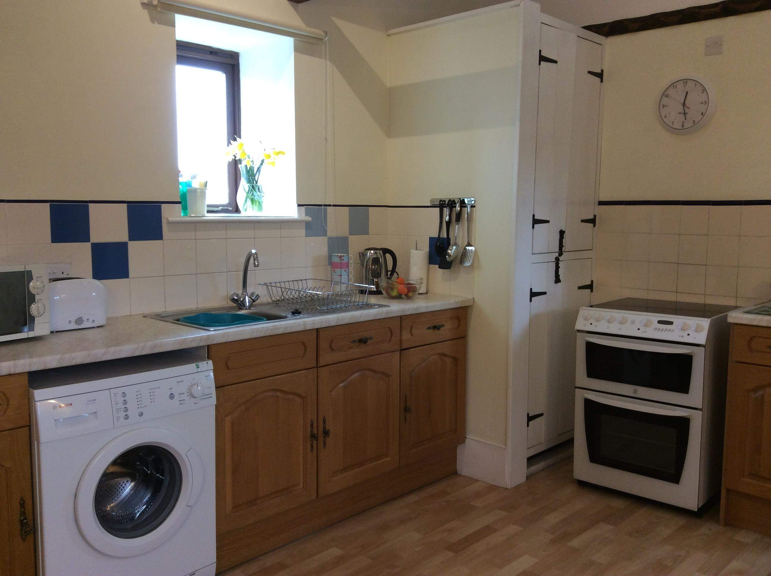 full size oven with ceramic hob and grill, microwave, full size fridge freezer, washing machine