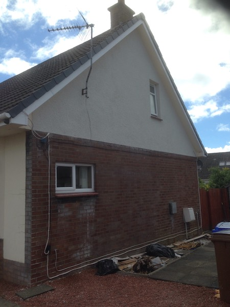 New roughcasting on the gable end of a chalet-style house in Ayr